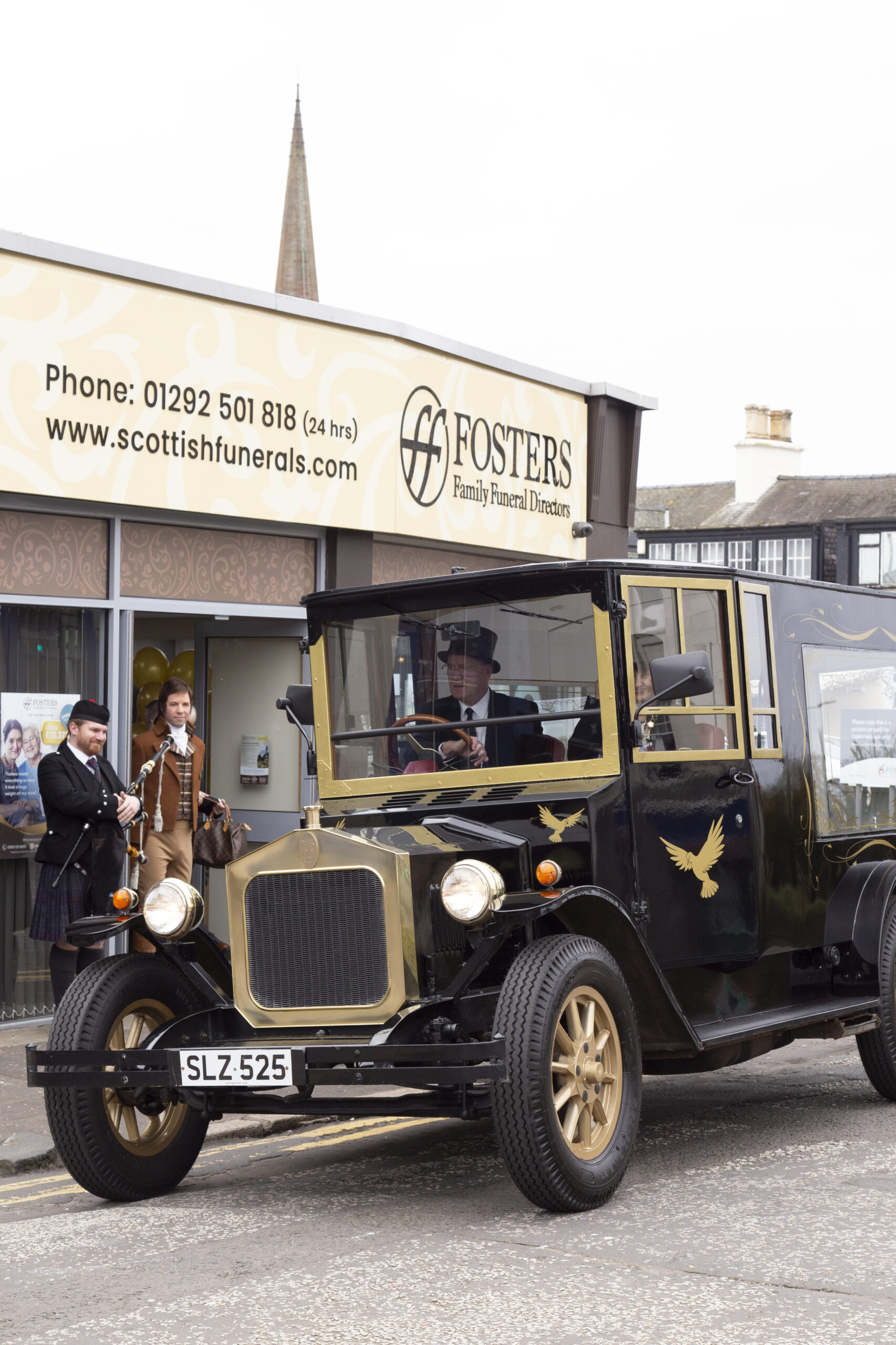 Classic Hearse outside Fosters funeral directors Burns statue square, Ayr