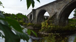 Fosters Stirling - a view of the arches of Stirling Bridge with the river flowing beneath it