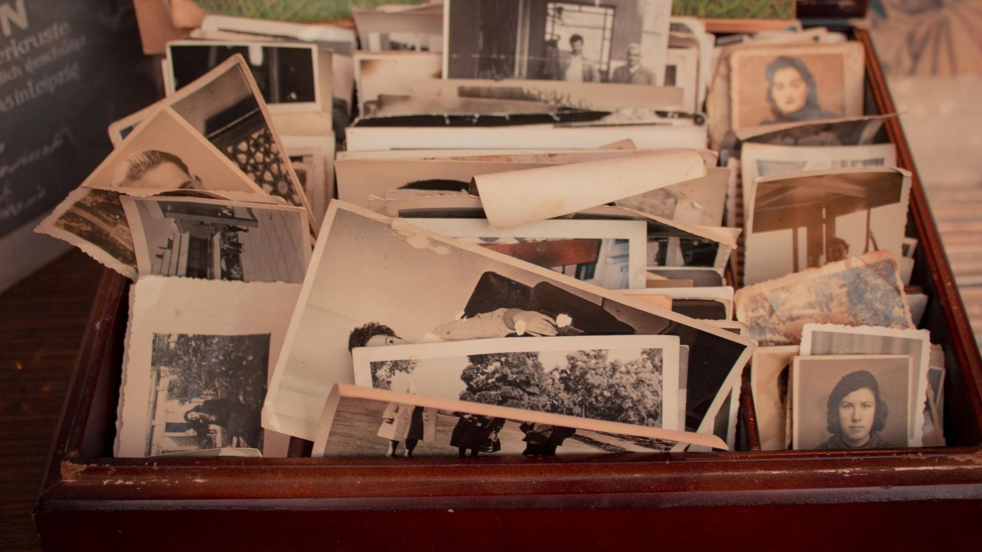 How to write a perfect eulogy - a wooden box containing old black and white photographs