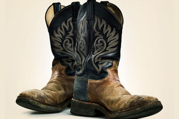 Personalised Funerals by Fosters - a pair of well worn cowboy boots in brown and black colours