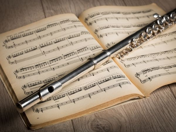 Personalised funeral Perth - a flute lies on top of a book of sheet music