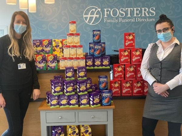 Geri and Sarah are photographed standing with pillars of lots of Easter eggs