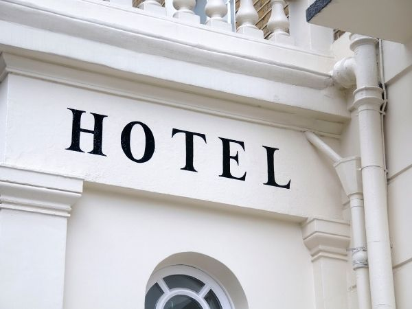 A hotel sign painted on a white building
