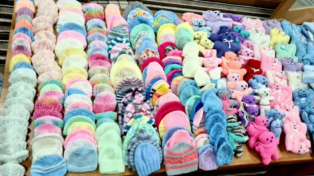 rows and rows of hand knitted baby hats