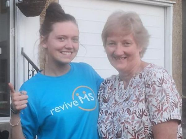 Fiona wears a blue Revive MS tshirt and is pictured with her Mum