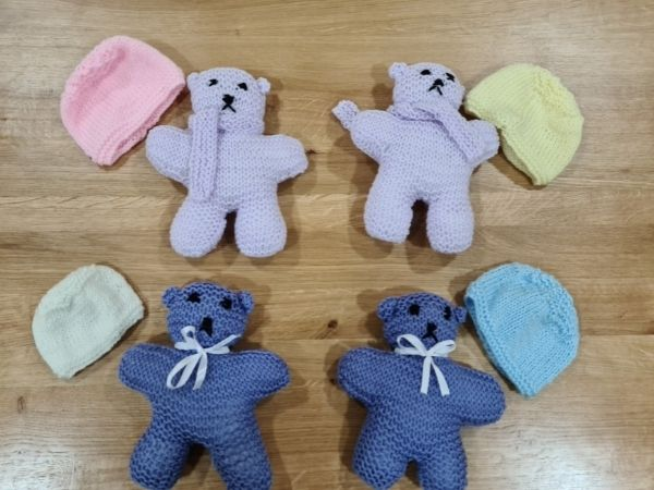 4 tiny baby hats and 2 pairs of matching knitted teddies